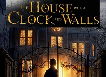 The House with a Clock in its Walls book cover. Showing haunted mansion at night with boy entering
